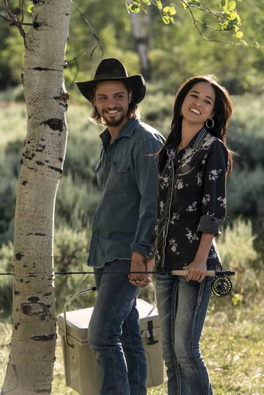 "(L-R) Luke Grimes as Kayce Dutton and Kelsey Asbille as Monica Dutton. Episode 4 of Yellowstone- ""Going Back to Cali"" premieres July 12 at 9 P.M. ET/PT on Paramount Network."