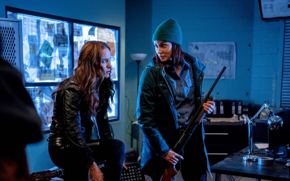 "WYNONNA EARP -- ""On the Road Again"" Episode 401 -- Pictured: (l-r) Melanie Scrofano as Wynonna Earp, Katherine Barrell as Officer Nicole Haught -- (Photo by: Michelle Faye/Wynonna Earp Productions, Inc./SYFY)"