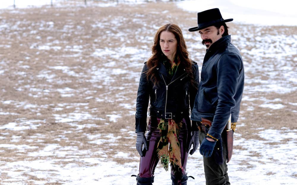 """WYNONNA EARP -- """"Holy War: Part 1"""" Episode 405 -- Pictured: (l-r) Melanie Scrofano as Wynonna Earp, Tim Rozon as Doc Holliday -- (Photo by: Michelle Faye/Wynonna Earp Productions, Inc./SYFY)"""
