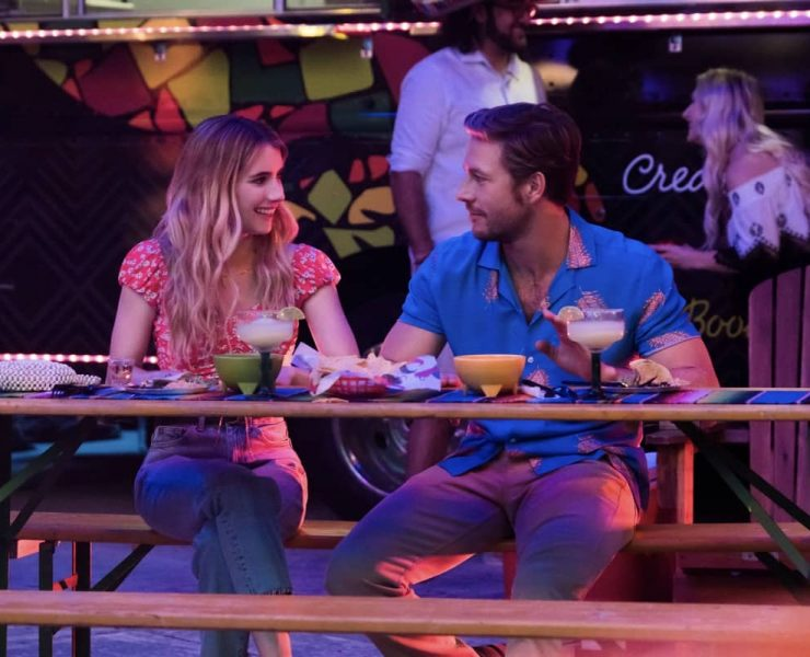 HOLIDATE (2020) L to R: Emma Roberts as Sloane Reed & Luke Bracey as Jackson Pieretti. Cr. Steve Dietl / Netflix