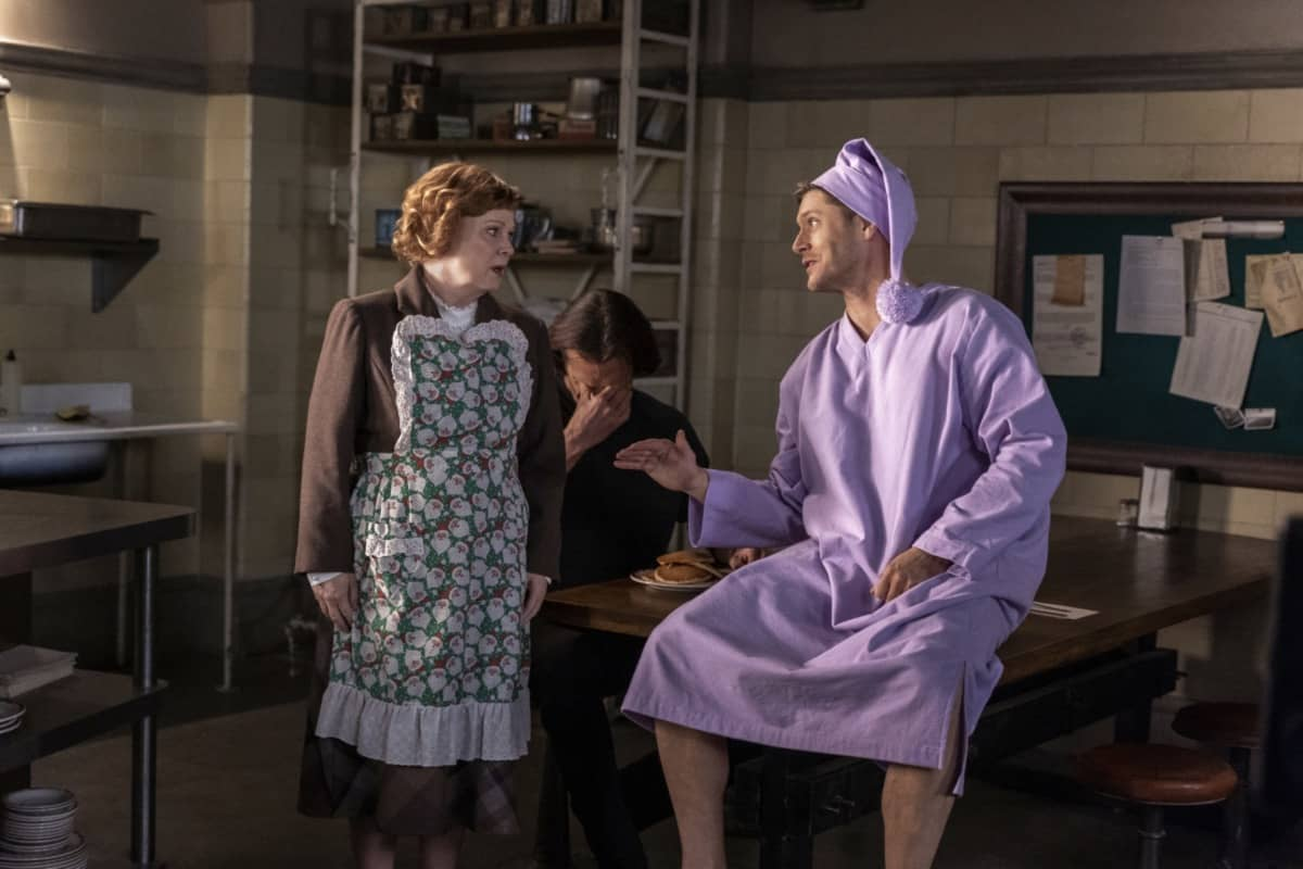"Supernatural -- ""Last Holiday"" -- Image Number: SN1514A_0390r.jpg -- Pictured (L-R): Meagen Fay as Mrs. Butters, Jared Padalecki as Sam and Jensen Ackles as Dean -- Photo: Colin Bentley/The CW -- © 2020 The CW Network, LLC. All Rights Reserved."