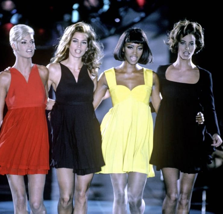"Linda Evangelista, Cindy Crawford, Naomi Campbell and Christy Turlington, pictured here at Gianni Versace's Fall 1991 show, will revisit their iconic modeling careers in ""The Supermodels."""