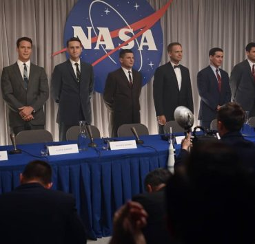 Back L to R: Micah Stock as Deke Slayton, Jake McDorman as Alan Shepard, Aaron Staton as Wally Schirra, Michael Trotter as Gus Grissom, Patrick J. Adams as John Glenn, Colin O'Donoghue as Gordon Cooper and James Lafferty as Scott Carpenter speak to the press