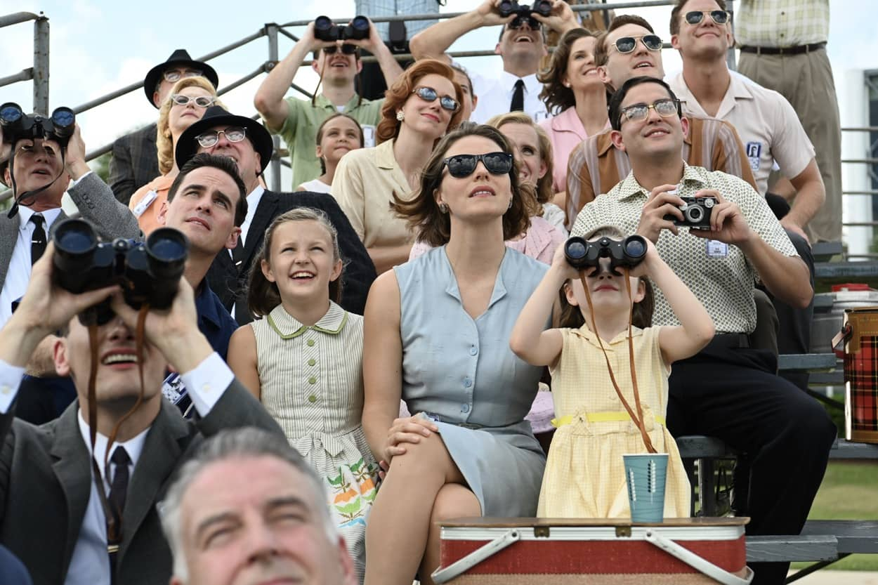Gordon Cooper played by Colin O'Donoghue and Trudy Cooper played by Eloise Mumford sit with their daughters watching the launch of a test rocket in National Geographic's THE RIGHT STUFF streaming on Disney+. (National Geographic/Gene Page)