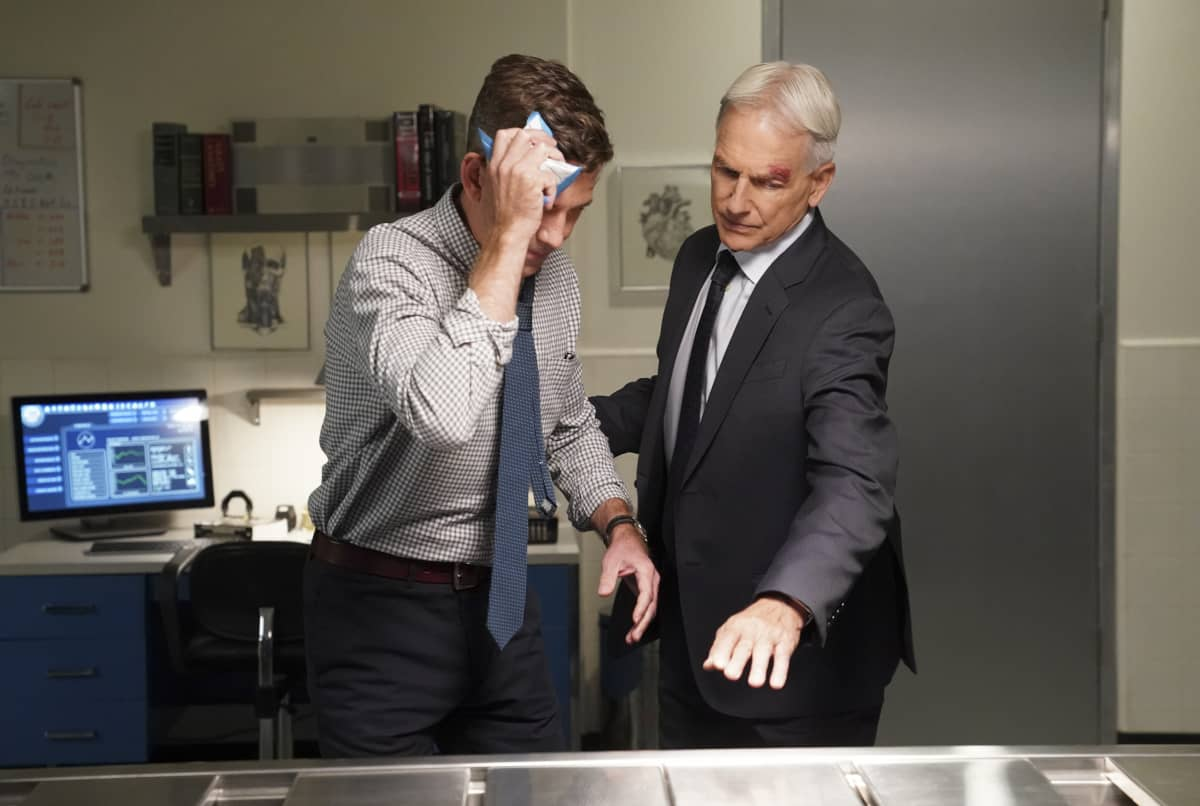 """Sturgeon Season"" -- Gibbs and Fornell (Joe Spano) attempt to track down the leader of a drug ring who supplied drugs to Fornell's daughter. Also, the team deals with the case of a missing cadaver from the NCIS autopsy room, on the 18th season premiere of NCIS, Tuesday, Nov. 17 (8:00-9:00 PM, ET/PT) on the CBS Television Network. Pictured: Brian Dietzen as Medical Examiner Dr. Jimmy Palmer, Mark Harmon as NCIS Special Agent Leroy Jethro Gibbs. Photo: Sonja Flemming/CBS ©2020 CBS Broadcasting, Inc. All Rights Reserved."