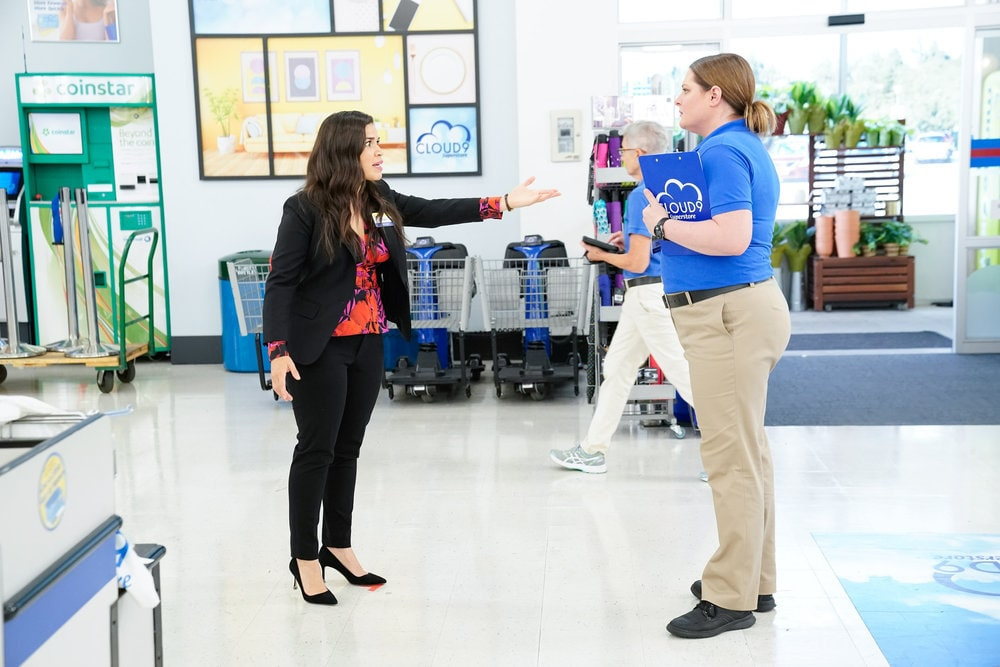 "SUPERSTORE -- ""Essential"" Episode 601 -- Pictured: (l-r) America Ferrera as Amy, Lauren Ash as Dina -- (Photo by: Greg Gayne/NBC)"