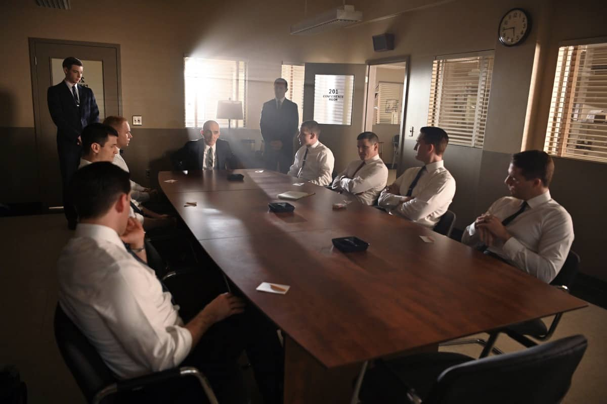 Glynn Lunney (back left) played by Jackson Pace and Chris Kraft (back right) played by Eric Ladin stand by as Bob Gilruth played by Patrick Fischler instructs the Mercury Seven to cast their peer vote which will determine the flight order of the first three astronauts in National Geographic's THE RIGHT STUFF streaming on Disney+. (National Geographic/Gene Page)
