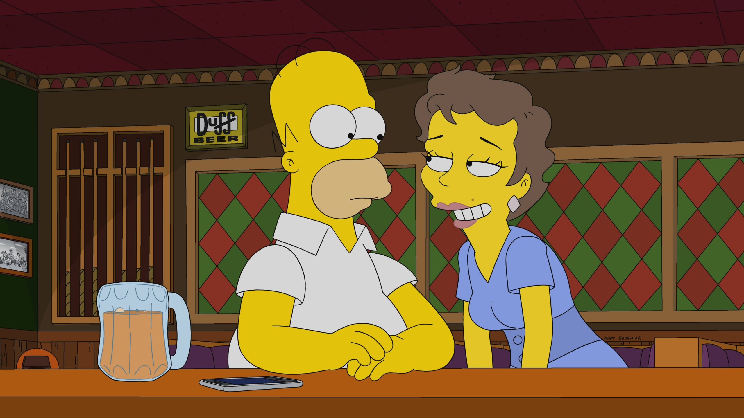 """THE SIMPSONS: When Marge and the kids take a seaside vacation, Homer is unwittingly tempted by a British femme fatale in the """"The 7 Beer Itch"""" episode of THE SIMPSONS airing Sunday, Nov. 8 (8:00-8:31 PM ET/PT) on FOX. Guest voice Olivia Colman. THE SIMPSONS © 2020 by Twentieth Century Fox Film Corporation."""