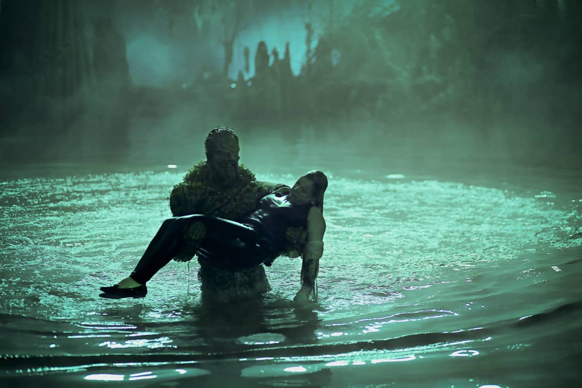 "Swamp Thing -- ""Drive All Night"" -- Image Number: SWP105c_0057 V2 -- Pictured (L - R): Virginia Madsen as Maria Sunderland and Derek Mears as Swamp Thing -- Photo: Fred Norris / 2020 Warner Bros. Entertainment Inc. -- © 2020 Warner Bros. Entertainment Inc. All Rights Reserved."