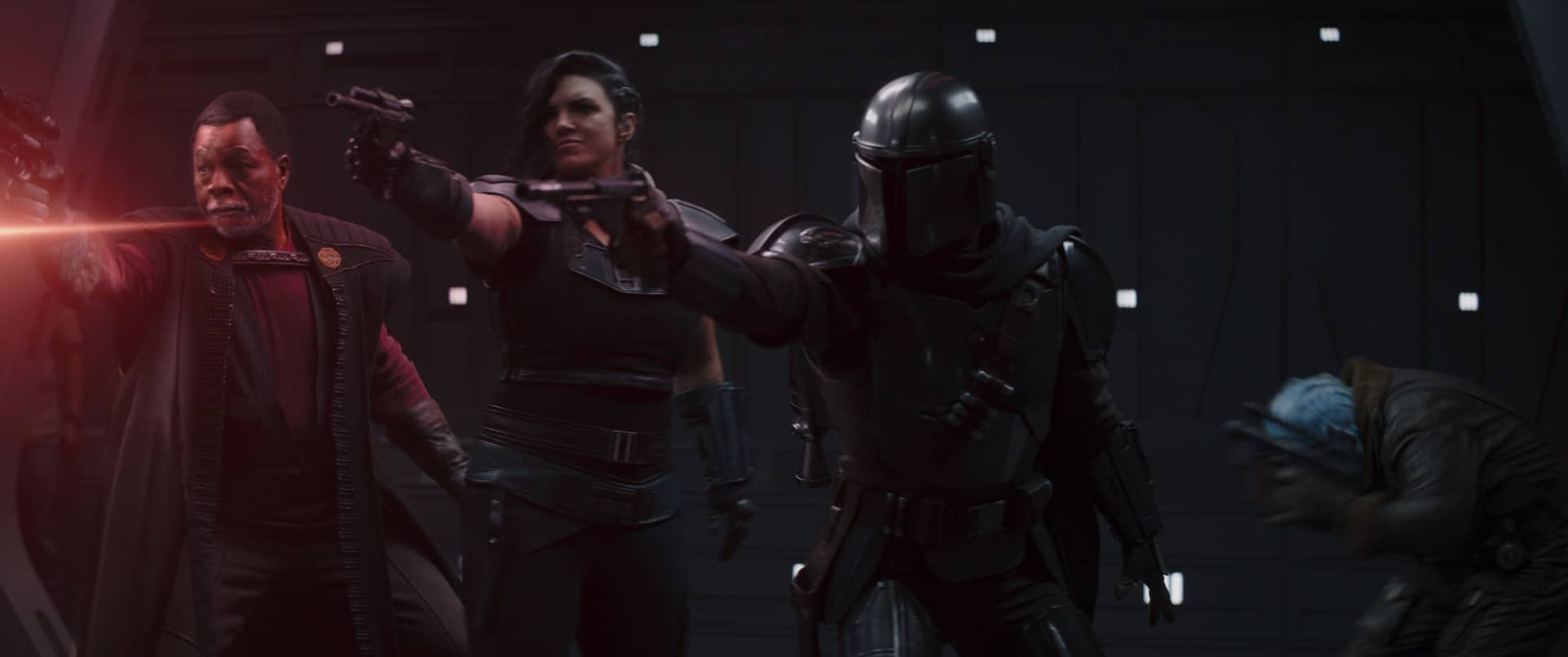 (L-R): Greef Karga (Carl Weathers), Cara Dune (Gina Carano), the Mandalorian (Pedro Pascal) and Mythrol (Horatio Sanz) in Lucasfilm's THE MANDALORIAN, season two, exclusively on Disney+. © 2020 Lucasfilm Ltd. & ™. All Rights Reserved.