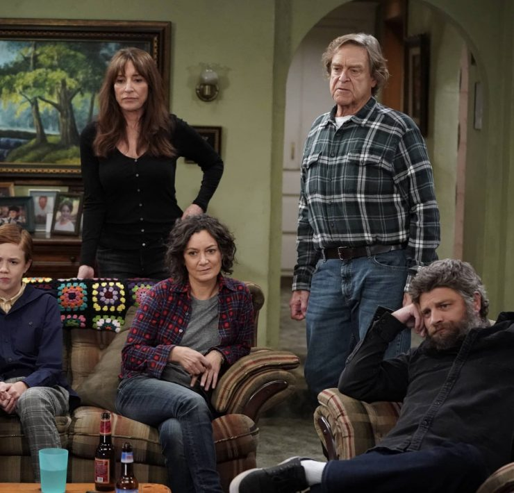 """THE CONNERS - """"Protest, Drug Test and One Leaves the Nest"""" – Harris' job is in jeopardy after joining a protest she strongly believes in, leading to tense discussions within the family. Jackie makes a visit to Wellman Plastics only to realize the company is instituting supervised drug testing, inspiring Becky to lead her own protest on an all-new episode of """"The Conners,"""" WEDNESDAY, DEC. 2 (9:00-9:30 p.m. EST), on ABC. (ABC/Eric McCandless) AMES MCNAMARA, KATEY SAGAL, SARA GILBERT, JOHN GOODMAN, JAY R. FERGUSON"""