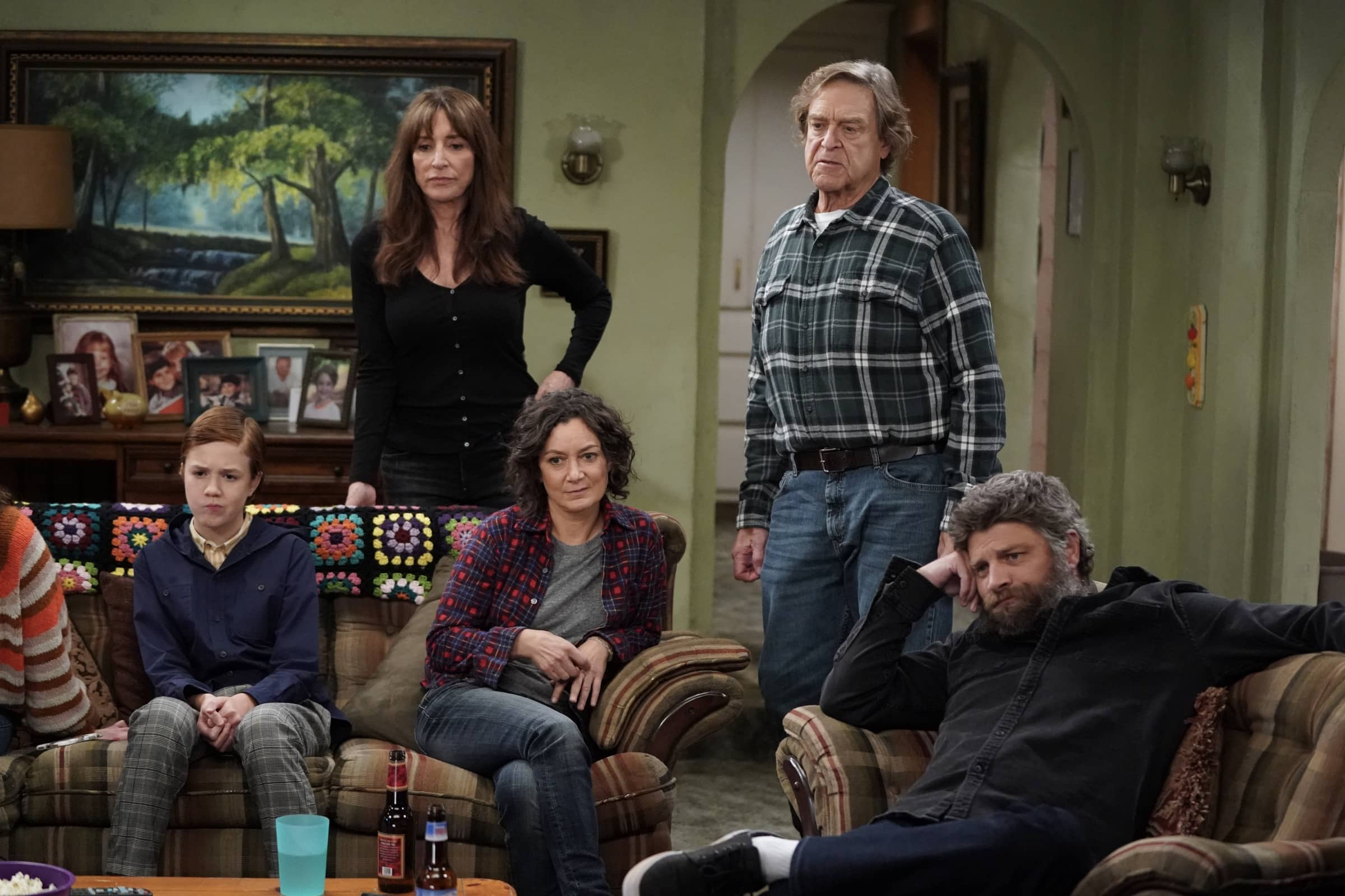 "THE CONNERS - ""Protest, Drug Test and One Leaves the Nest"" – Harris' job is in jeopardy after joining a protest she strongly believes in, leading to tense discussions within the family. Jackie makes a visit to Wellman Plastics only to realize the company is instituting supervised drug testing, inspiring Becky to lead her own protest on an all-new episode of ""The Conners,"" WEDNESDAY, DEC. 2 (9:00-9:30 p.m. EST), on ABC. (ABC/Eric McCandless) AMES MCNAMARA, KATEY SAGAL, SARA GILBERT, JOHN GOODMAN, JAY R. FERGUSON"