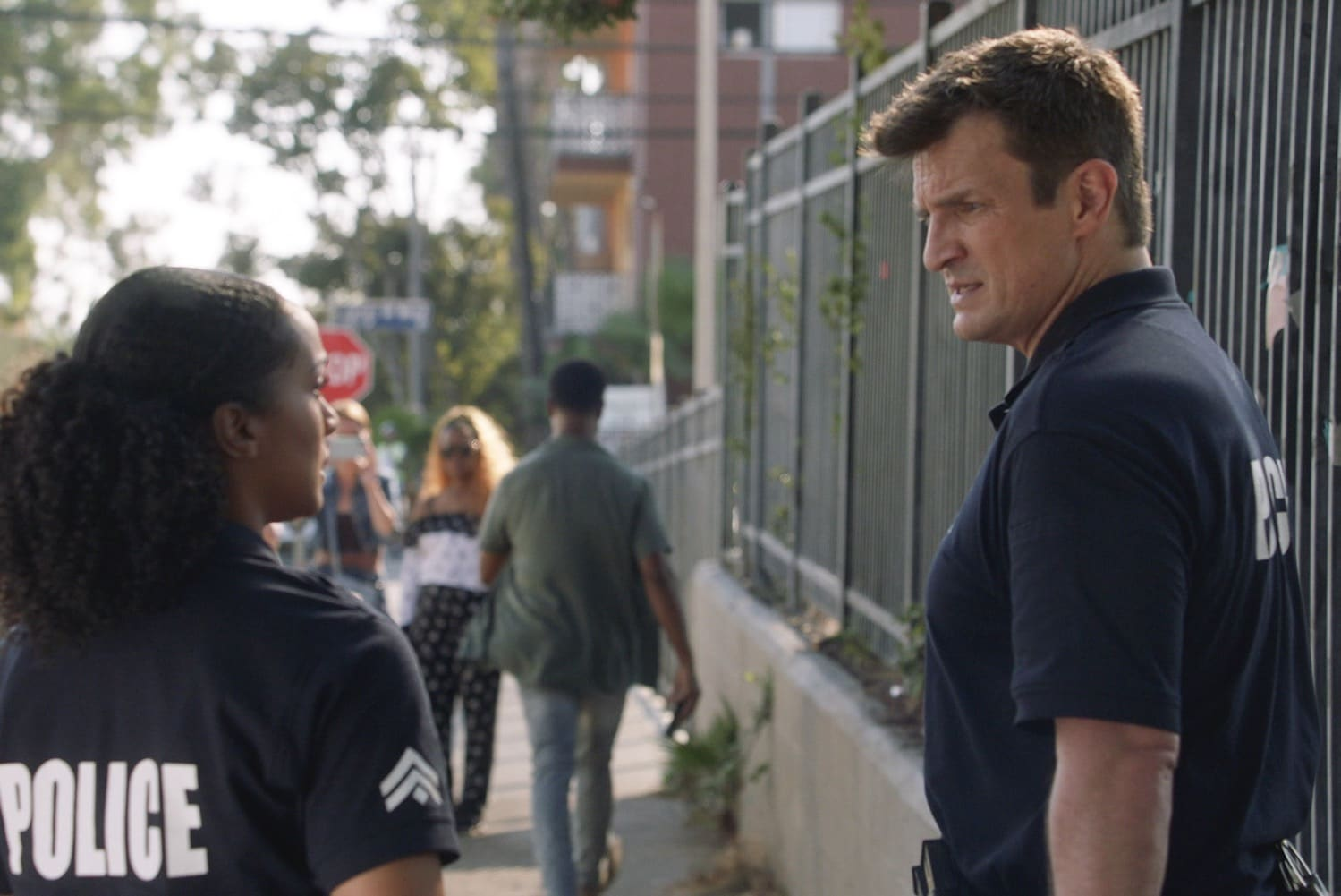 """THE ROOKIE Season 3 Episode 2 - """"In Justice"""" – Officer John Nolan and Officer Nyla Harper are assigned to a community policing center to help rebuild their station's reputation in the community. Nolan is determined to make a positive impact but Nyla has her doubts on """"The Rookie,"""" SUNDAY, JAN. 10 (10:00-11:00 p.m. EST), on ABC. (ABC) NATHAN FILLION"""