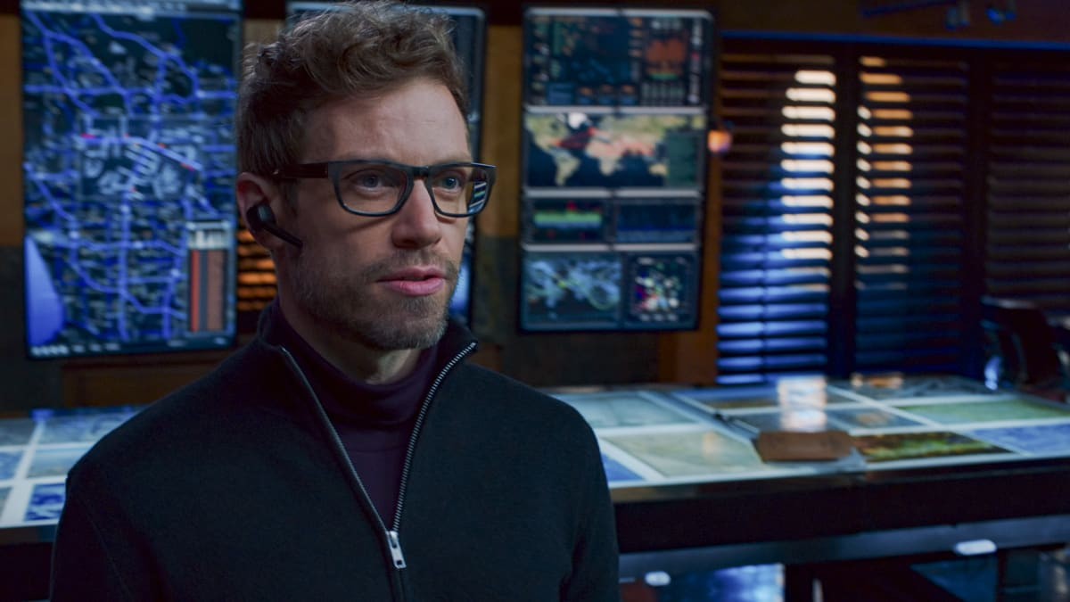 """NCIS LOS ANGELES Season 12 Episode 9 """"A Fait Accompli"""" - Pictured: Barrett Foa (Tech Operator Eric Beale). While NCIS must track down an organized crime leader who is trying to buy stolen defense technology, Callen goes to Anna to ask the ultimate question. Also, Deeks is kicked out of NCIS training only to find that Hetty has a life-changing surprise for him, on NCIS: LOS ANGELES, Sunday, Jan. 17 (8:00-9:00 PM, ET/PT) on the CBS Television Network Photo: Screen Grab/CBS ©2020 CBS Broadcasting, Inc. All Rights Reserved."""