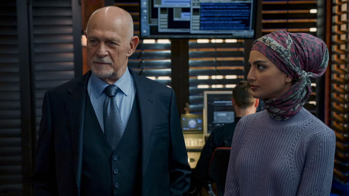 """""""Russia, Russia, Russia"""" - Pictured: Gerald McRaney (Retired Navy Admiral Hollace Kilbride) and Medalion Rahimi (Special Agent Fatima Namazi)."""