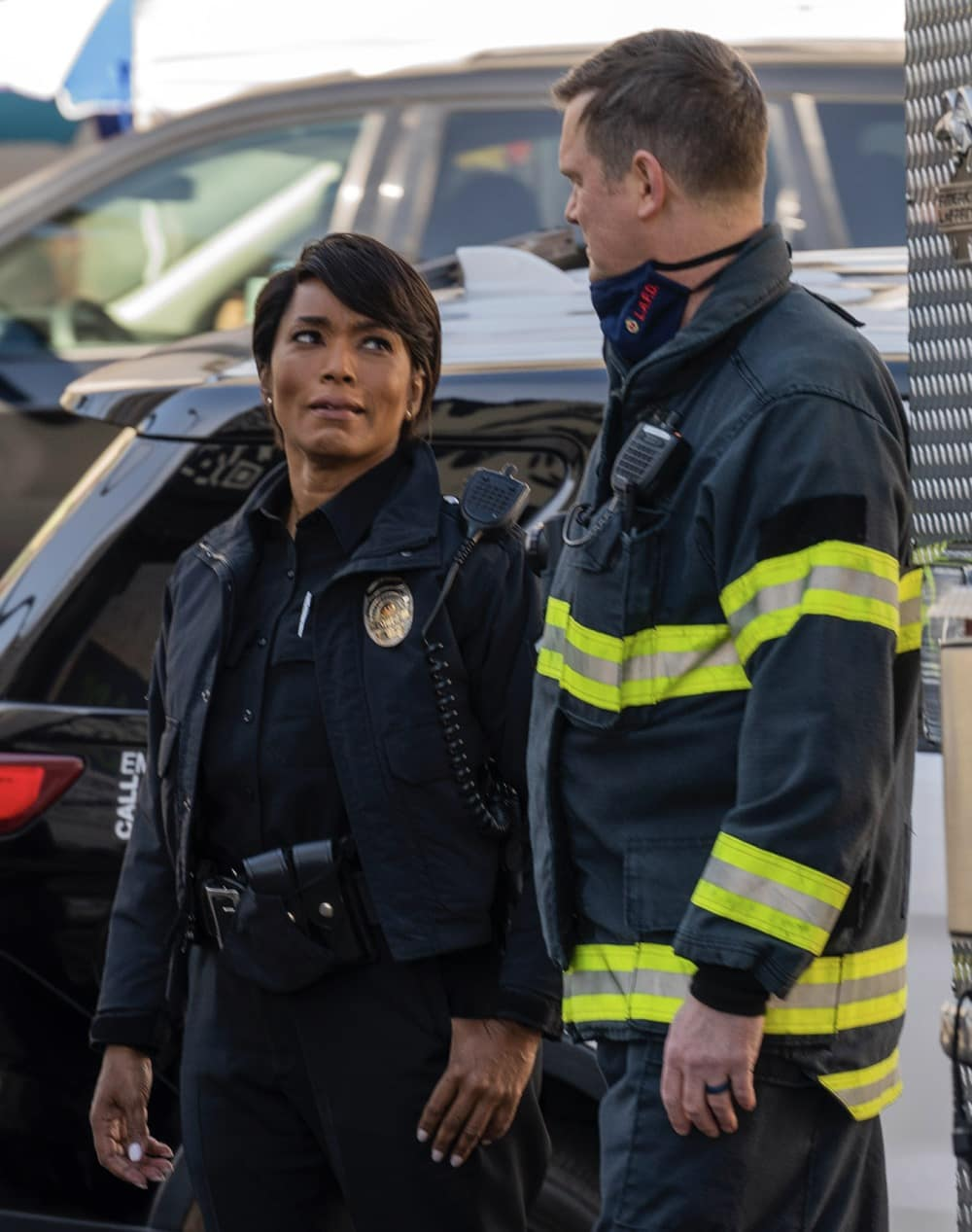 "9-1-1 Season 4 Episode 6 : L-R: Angela Bassett and Peter Krause in the ""Jinx"" episode of 9-1-1 airing Monday, Feb. 22 (8:00-9:00 PM ET/PT) on FOX. CR: Jack Zeman / FOX. © 2021 FOX Media LLC."