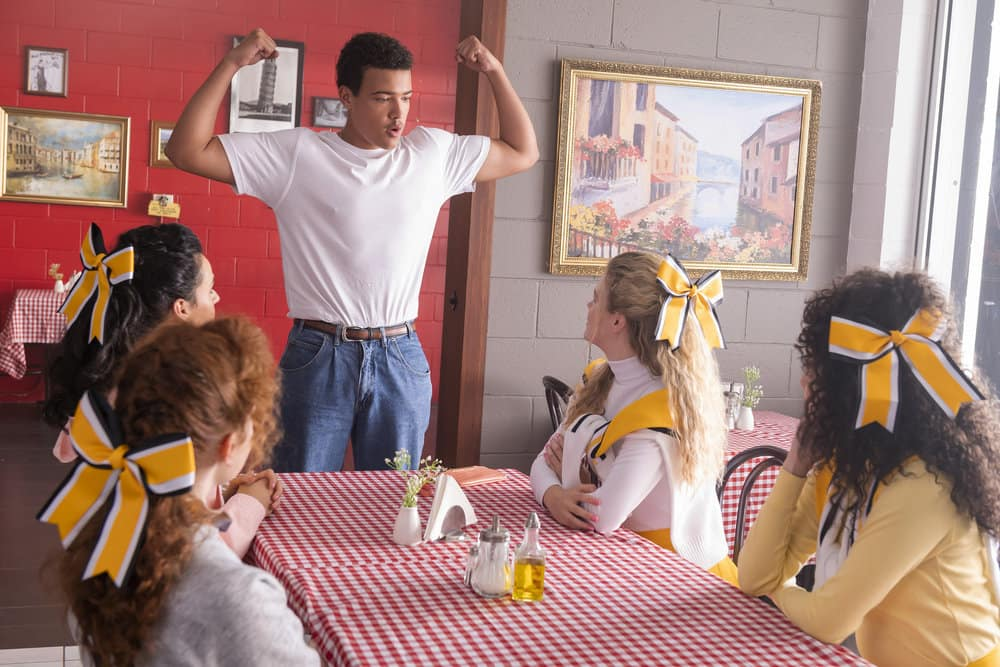 """YOUNG ROCK Season 1 Episode 2 -- """"On the Road Again"""" Episode 102 -- Pictured: (l-r) Bradley Constant as Dwayne, Lexie Duncan as Karen, Gaby Seow as Big Haired Karen, Carly Daniels as Colorblind Karen -- (Photo by: Mark Taylor/NBC)"""