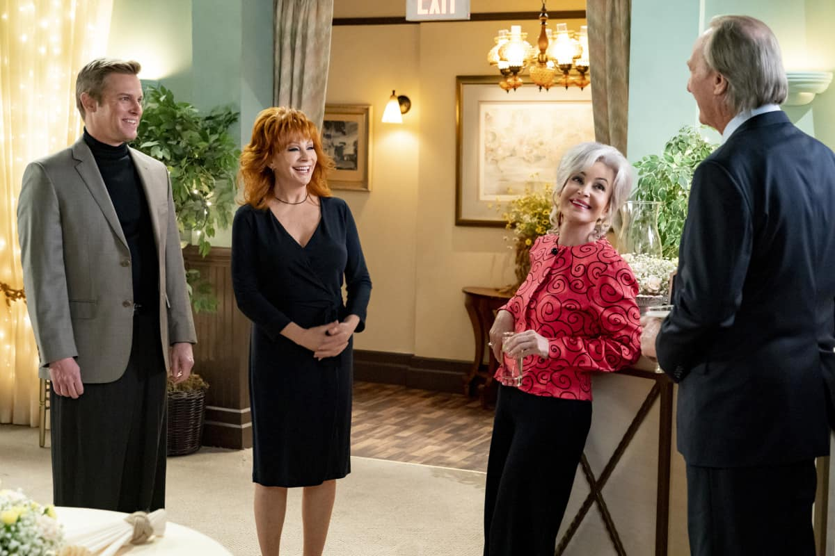 "Young Sheldon Season 4 Episode 9 ""Crappy Frozen Ice Cream and an Organ Grinder's Monkey"" - Pictured: Justin (Travis Schuldt), June (Reba McEntire), Meemaw (Annie Potts) and Dale (Craig T. Nelson). Sheldon and George Sr. dine with President Hagemeyer (Wendie Malick) and a university benefactor. Also, Georgie gives Missy some brotherly advice when Mary won't let her go to the school dance, and Dale and June (Reba McEntire) convince Meemaw to attend their son's wedding"