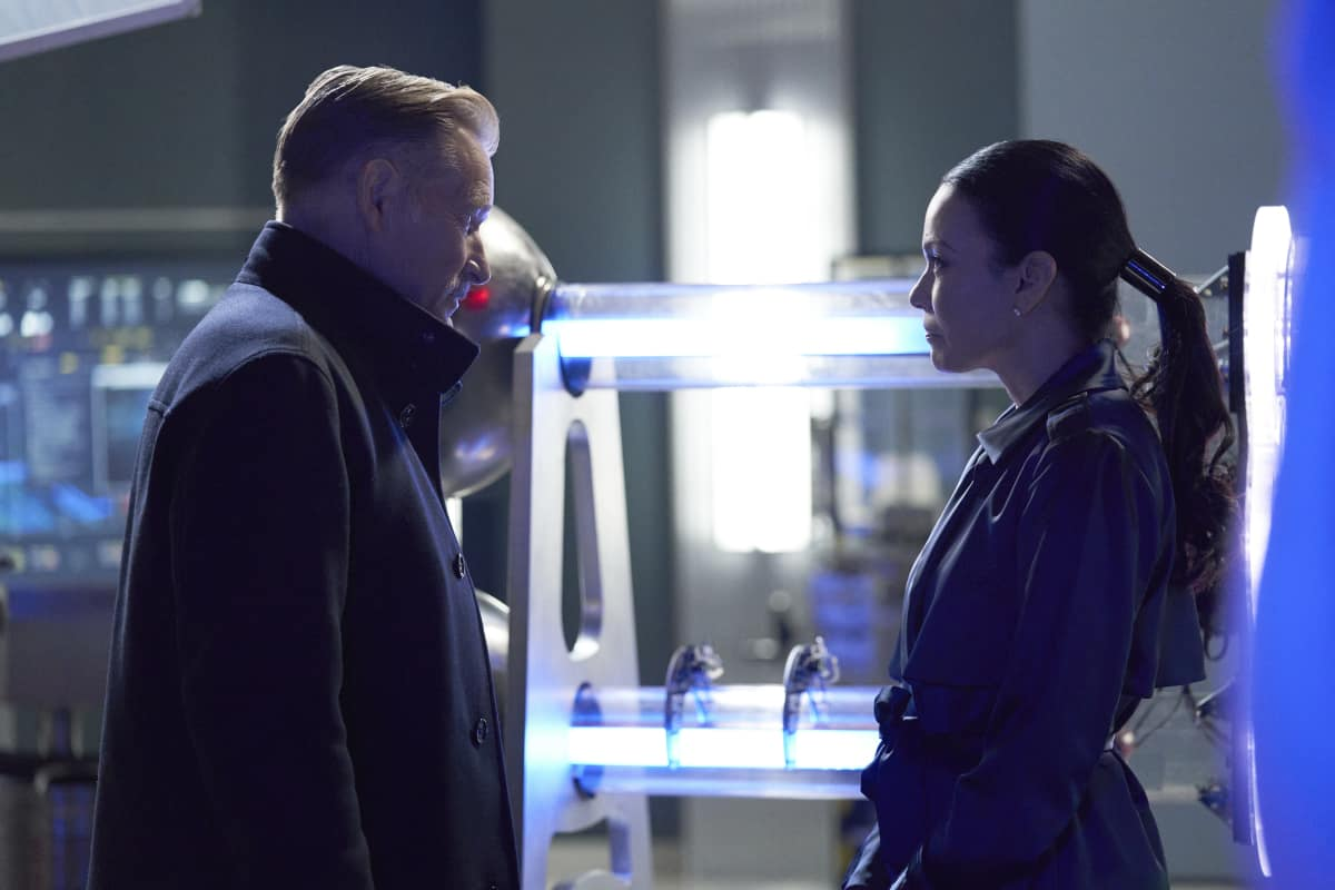 """Black Lightning Season 4 Episode 4 -- """"The Book of Reconstruction: Chapter Four"""" -- Image Number: BLK404A_0263r.jpg -- Pictured (L-R): James Remar as Gambi and Elena Varela as Lauren Caruso -- Photo: Bob Mahoney/The CW -- © 2021 The CW Network, LLC. All rights reserved."""