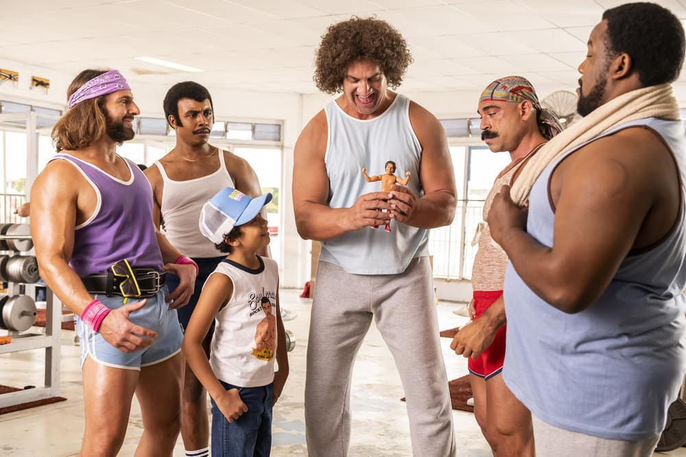 """Young Rock Season 1 Episode 3 -- """"Forward Together"""" Episode 103 -- Pictured: (l-r) Kevin Makely as Macho Man, Joseph Lee Anderson as Rocky Johnson, Adrian Groulx as Dwayne, Matthew Willig as Andre The Giant, Brett Azar as The Iron Sheik, Nate Jackson as Junkyard Dog -- (Photo by: Mark Taylor/NBC)"""