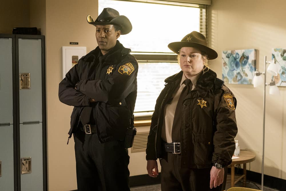 "RESIDENT ALIEN Season 1 Episode 6 -- ""Sexy Beast"" Episode 106 -- Pictured: (l-r) Corey Reynolds as Sherriff Mike Thompson, Elizabeth Bowen as Deputy Liv -- (Photo by: James Dittinger/SYFY)"