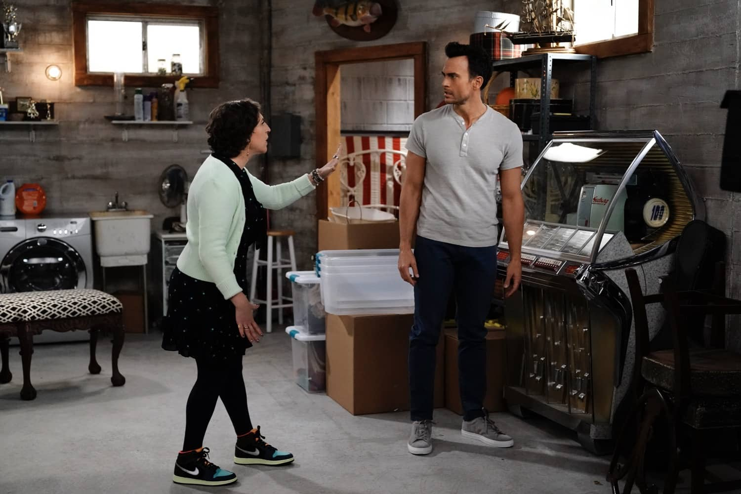 """CALL ME KAT Season 1 Episode 10 : L-R: Mayim Bialik and Cheyenne Jackson in the """"Business Council"""" episode of CALL ME KAT airing Thursday, March 4 (9:00-9:30 PM ET/PT) on FOX. ©2021 FOX MEDIA LLC. Cr. Cr: Lisa Rose/FOX."""