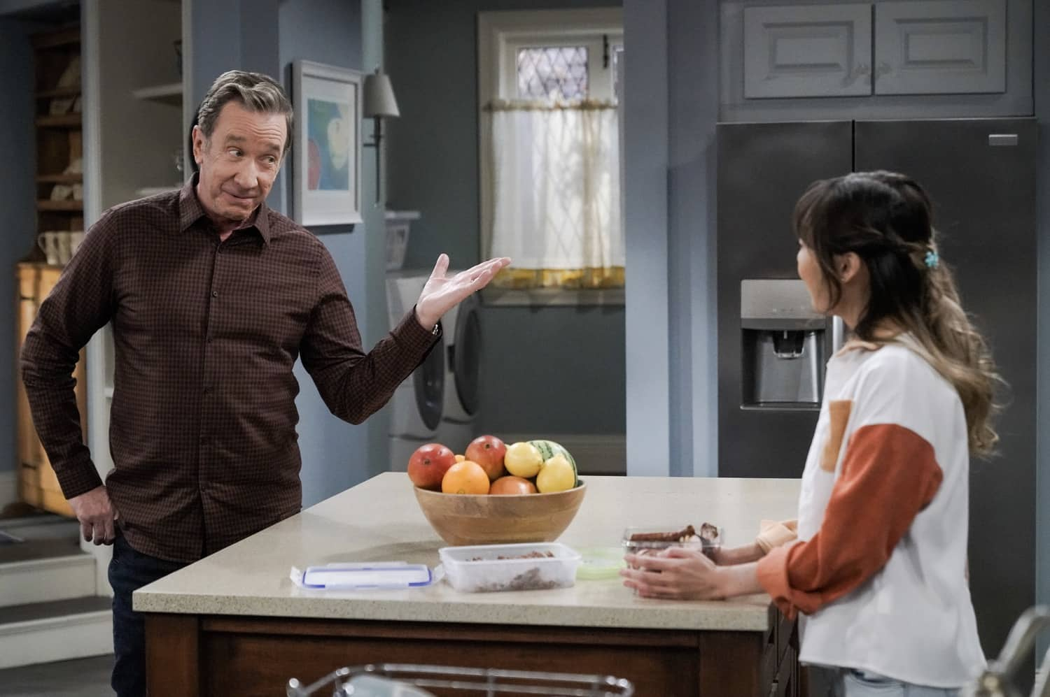 "LAST MAN STANDING Season 9 Episode 10 : L-R: Tim Allen and Krista Marie Yu in the ""Meatless Mike"" episode of LAST MAN STANDING airing Thursday, March 4 (9:30-10:00 PM ET/PT) on FOX. CR: Michael Becker/FOX. © 2021 FOX Media LLC."