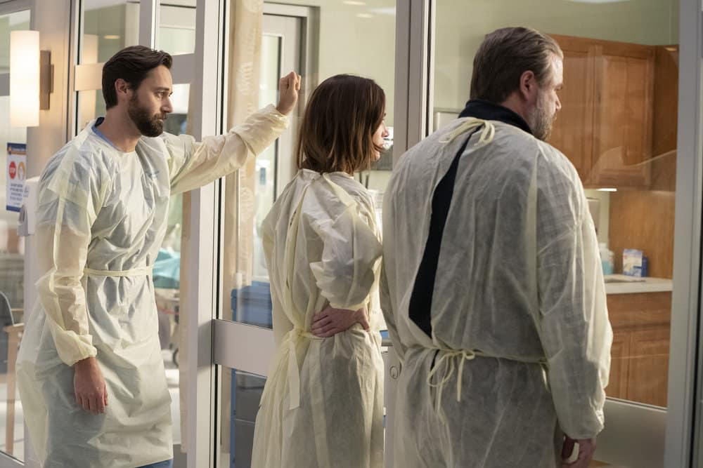 """NEW AMSTERDAM Season 3 Episode 2 -- """"Essential Workers"""" Episode 302 -- Pictured: (l-r) Ryan Eggold as Dr. Max Goodwin, Janet Montgomery as Dr. Lauren Bloom, Tyler Labine as Dr. Iggy Frome -- (Photo by: Virginia Sherwood/NBC)"""