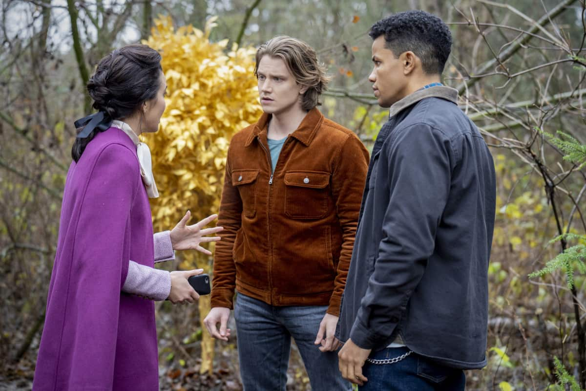 """Nancy Drew -- """"The Quest for the Spider Sapphire"""" -- Image Number: NCD208a_0450r.jpg -- Pictured (L-R): Maddison Jaizani as Bess, Alex Saxon as Ace and Tunji Kasim as Nick -- Photo: Colin Bentley/The CW -- © 2021 The CW Network, LLC. All Rights Reserved."""