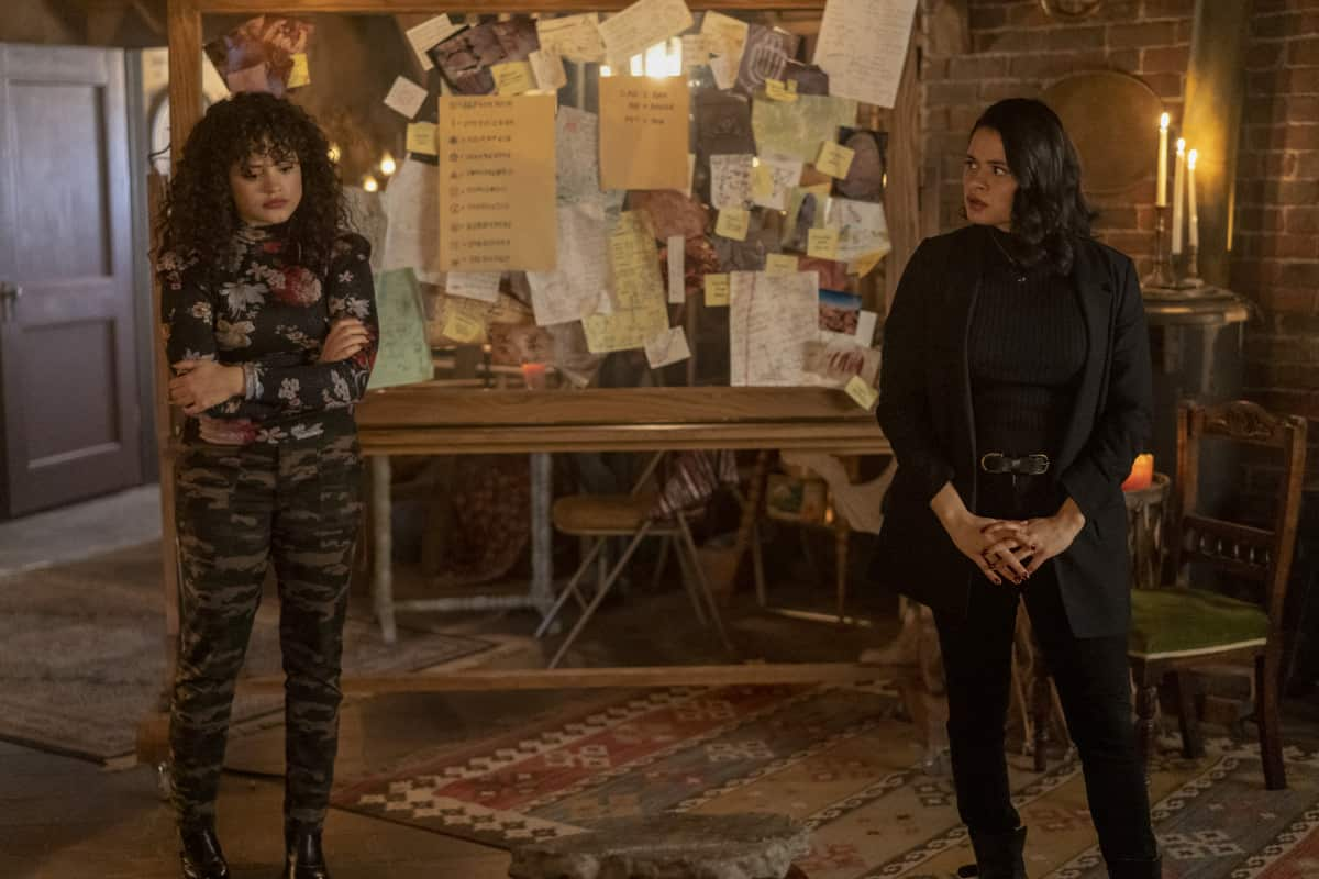 """Charmed -- """"Witch Way Out"""" -- Image Number: CMD307a_ 0112r -- Pictured (L - R): Sarah Jeffery as Maggie Vera and Melonie Diaz as Mel Vera -- Photo: Colin Bentley/The CW -- © 2021 The CW Network, LLC. All Rights Reserved."""
