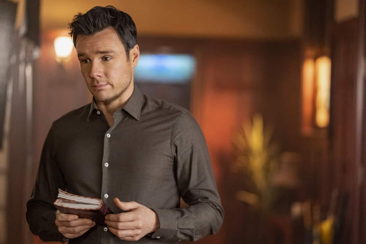 """Charmed -- """"Witch Way Out"""" -- Image Number: CMD307a_ 0528r -- Pictured:  Rupert Evans as Harry Greenwood -- Photo: Colin Bentley/The CW -- © 2021 The CW Network, LLC. All Rights Reserved."""
