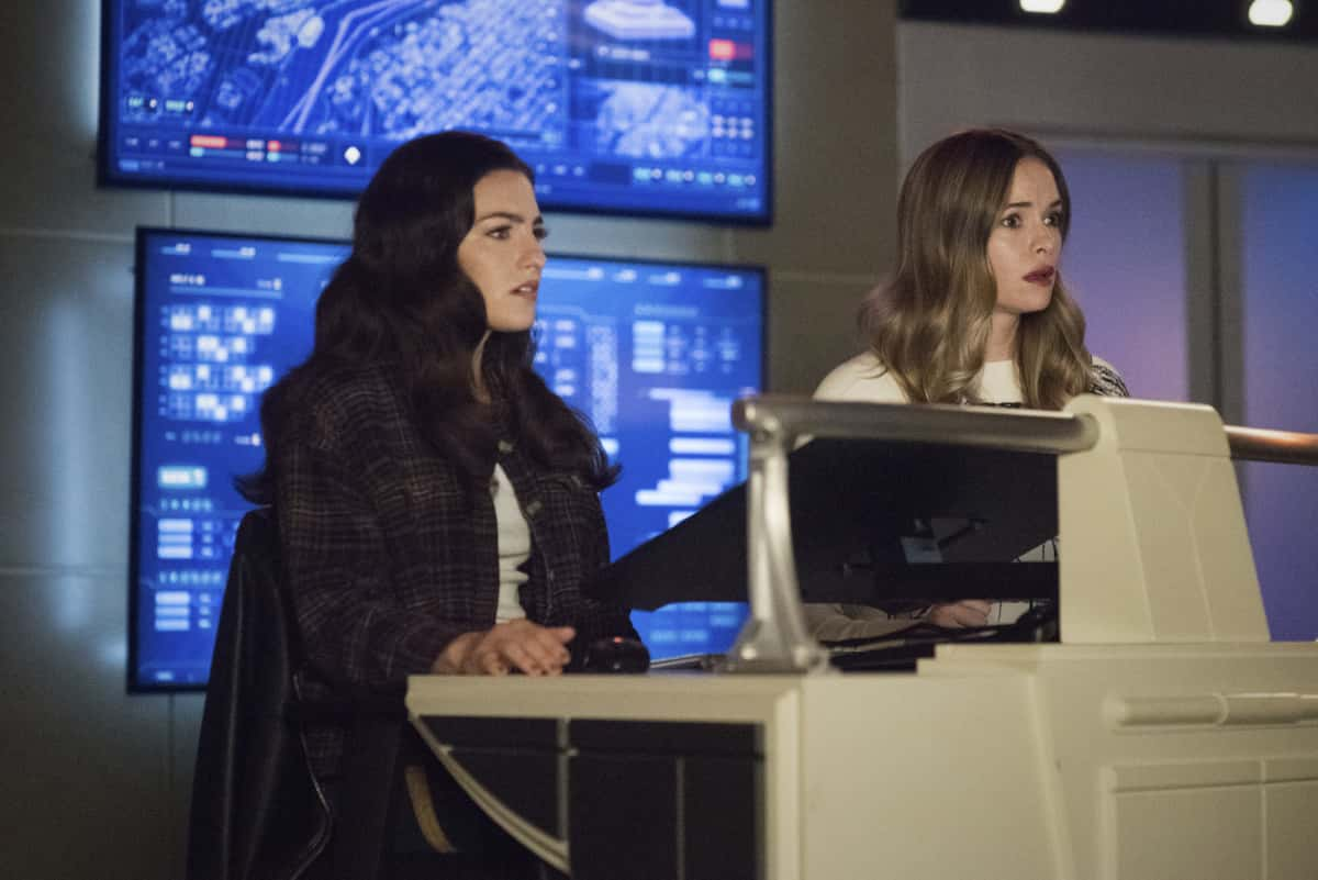 """The Flash -- """"Central City Strong"""" -- Image Number: FLA704b_0034r.jpg -- Pictured (L-R):  Kayla Compton as Allegra and Danielle Panabaker as Caitlin Snow -- Photo: Katie Yu/The CW -- © 2021 The CW Network, LLC. All rights reserved"""