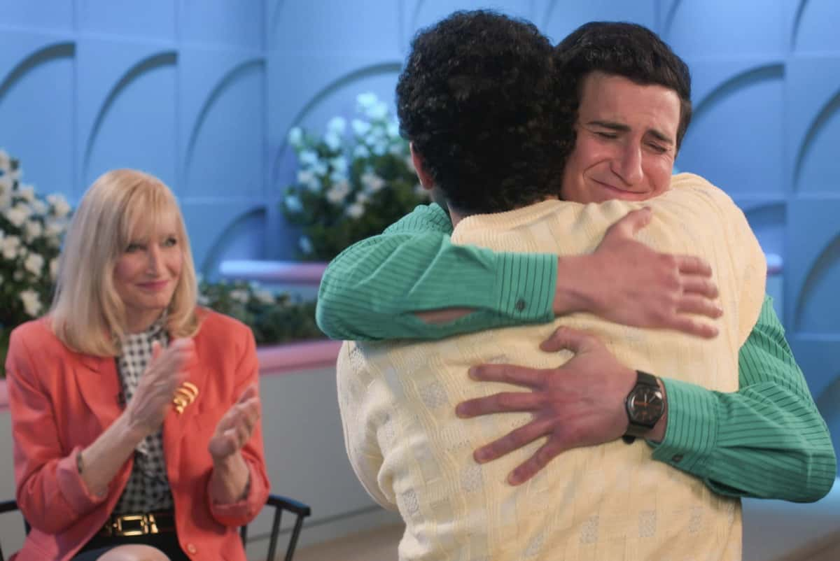 """THE GOLDBERGS Season 8 Episode 14 - """"Love Triangle"""" - As Adam's girlfriend, Brea, heads to visit her cousin at the University of Virginia (UVA), Beverly projects her own insecurity onto Adam, convincing him to do a grand gesture to prevent Brea from choosing UVA for college. Meanwhile, when Geoff asks Erica to go to the local Nancy Glass talk show with him, a disappointed Barry teams up with Geoff's sister Joanne to change his mind on a new episode of """"The Goldbergs,"""" WEDNESDAY, MARCH 24 (8:00-8:30 p.m. EDT), on ABC. (ABC) NANCY GLASS, SAM LERNER"""