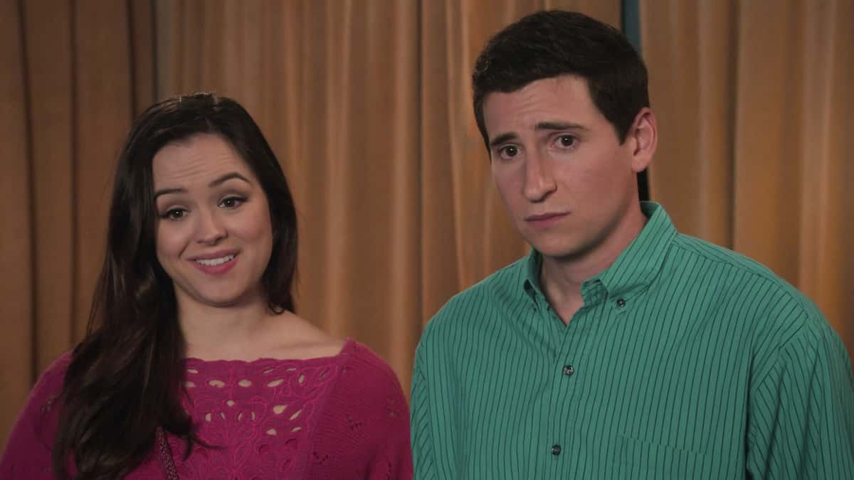 """THE GOLDBERGS Season 8 Episode 14 - """"Love Triangle"""" - As Adam's girlfriend, Brea, heads to visit her cousin at the University of Virginia (UVA), Beverly projects her own insecurity onto Adam, convincing him to do a grand gesture to prevent Brea from choosing UVA for college. Meanwhile, when Geoff asks Erica to go to the local Nancy Glass talk show with him, a disappointed Barry teams up with Geoff's sister Joanne to change his mind on a new episode of """"The Goldbergs,"""" WEDNESDAY, MARCH 24 (8:00-8:30 p.m. EDT), on ABC. (ABC) HAYLEY ORRANTIA, SAM LERNER"""