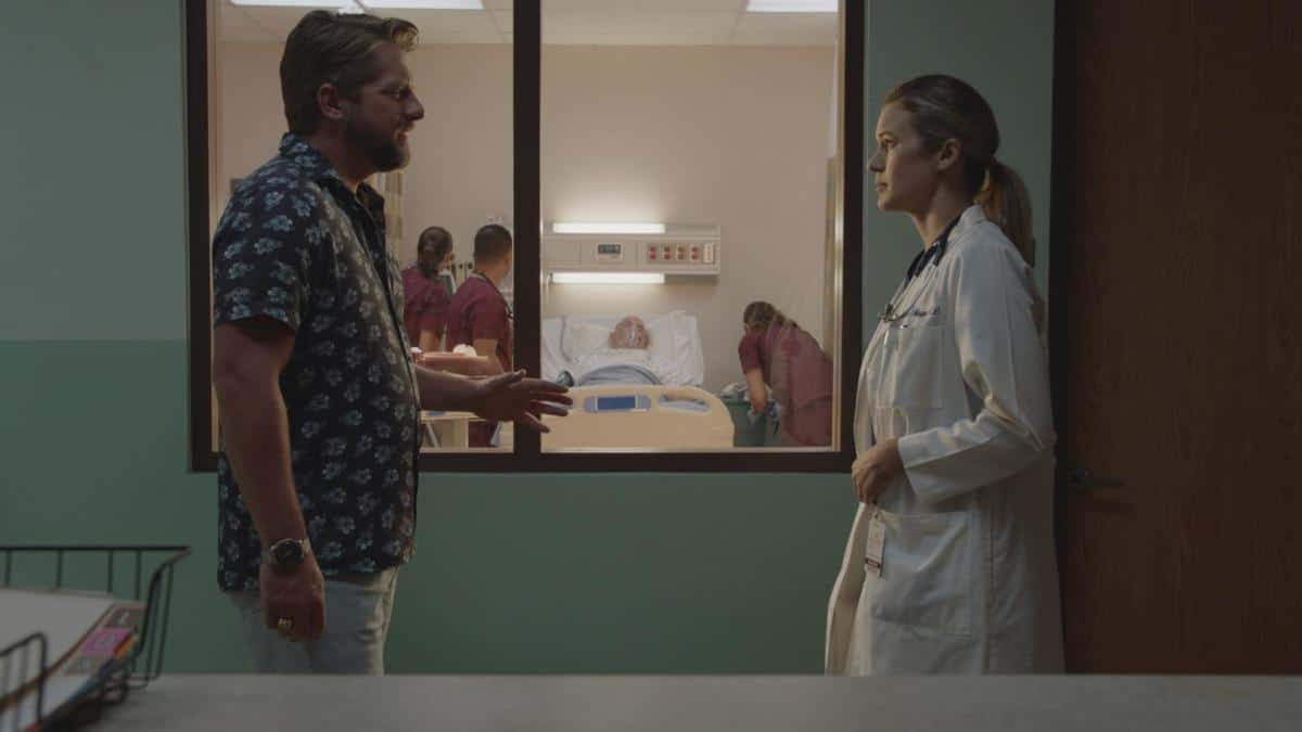 """Magnum P.I. Season 3 Episode 11 """"The Lies We Tell"""" -- When a married woman asks Magnum and Higgins to find her lover\'s killer because she doesn\'t want to expose the affair to the police, they find that the victim wasn\'t who he claimed to be. Also, Rick visits Icepick (Corbin Bernsen), whose health has taken a turn for the worse, on MAGNUM P.I., Friday, March 26 (9:00-10:00 PM, ET/PT) on the CBS Television Network. Pictured L-R: Zachary Knighton as Orville """"Rick"""" Wright, Corbin Bersen as Icepick, and Sarah Halford as Doctor Photo: Screen Grab/CBS 2021 CBS Broadcasting, Inc. All Rights Reserved."""