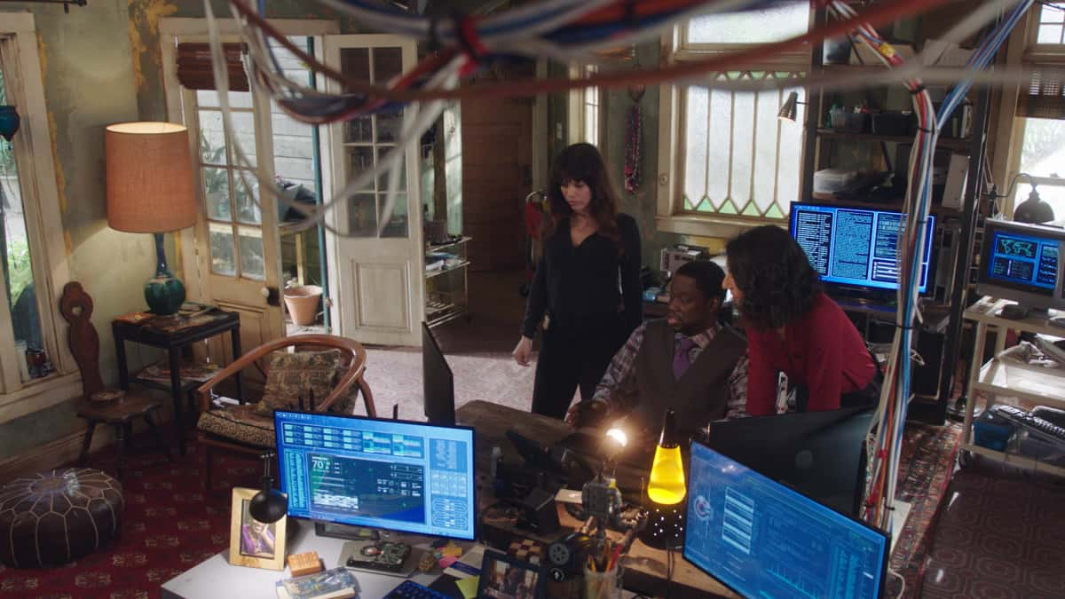 """NCIS New Orleans Season 7 Episode 11 """"Stashed"""" -- Sebastian\'s life is in danger when a criminal he put behind bars escapes police custody. Also, Carter is tasked with keeping Sebastian in protective custody and Carter and Hannah\'s flirtation is fun gossip fodder for Tammy and Sebastian, on """"NCIS: NEW ORLEANS,"""" Sunday, March 26 (10:00-11:00 PM, ET/PT) on the CBS Television Network. Pictured L-R: Vanessa Ferlito as Special Agent Tammy Gregorio, Daryl """"Chilli"""" Mitchell as Patton Plame, and Necar Zadegan as Special Agent Hannah Khoury Photo: Screen Grab/CBS 2021 CBS Broadcasting, Inc. All Rights Reserved."""