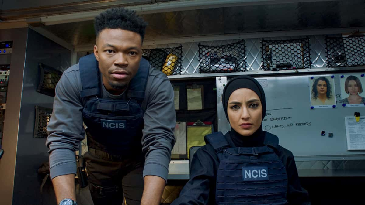 """NCIS Los Angeles Season 12 Episode 13 """"Red Rover, Red Rover"""" - Pictured: Caleb Castille (Special Agent Devin Rountree) and Medalion Rahimi (Special Agent Fatima Namazi). To rescue Joelle from further torture by the Russians, Callen and NCIS must offer up Anna as bait to Katya. Also, Callen finally discovers who accused him of being Russian spy, on NCIS: LOS ANGELES, Sunday, March 28 (9:00-10:00 PM, ET/PT) on the CBS Television Network. Photo: Screen Grab/CBS ©2021 CBS Broadcasting, Inc. All Rights Reserved."""