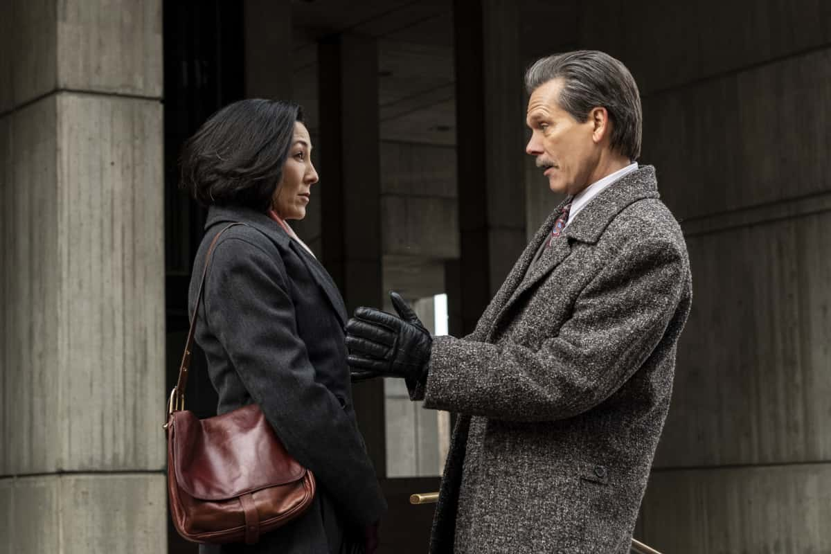 """City On A Hill Season 2 Episode 1 (L-R): Keiko Elizabeth as Karen Shimizu and Kevin Bacon as Jackie Rohr in CITY ON A HILL, """"Bill Russell's Bedsheets"""". Photo Credit: Francisco Roman/SHOWTIME."""