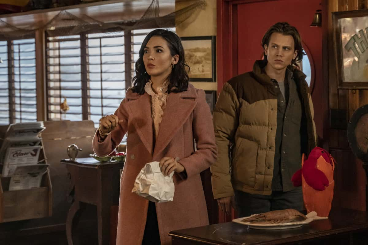 """Nancy Drew Season 2 Episode 10 -- """"The Spell of The Burning Bride"""" -- Image Number: NCD210b_0191r.jpg -- Pictured (L-R): Maddison Jaizani as Bess and Alex Saxon as Ace -- Photo: Colin Bentley/The CW -- © 2021 The CW Network, LLC. All Rights Reserved."""