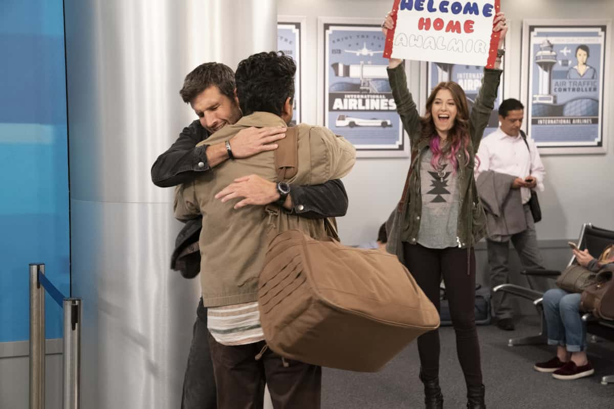 """United States Of Al Season 1 Episode 1 """"Pilot"""" -- Riley (Parker Young), a marine combat veteran is struggling to adjust to civilian life in Ohio and the interpreter, Al (Adhir Kalyan), who served with his unit in Afghanistan has just arrived to start a new life in America, on the series premiere of """"United States of Al,"""" Thursday, April 1 (8:30-9:00 PM, ET/PT) on the CBS Television Network. Dean Norris, Elizabeth Alderfer, Kelli Goss and Farrah Mackenzie also star.  Pictured:  Parker Young as Riley, Adhir Kalyan as Al. Elizabeth Alderfer as Lizzie. Photo Credit: Robert Voets/CBS Entertainment ©2020 CBS Broadcasting, Inc. All Rights Reserved."""