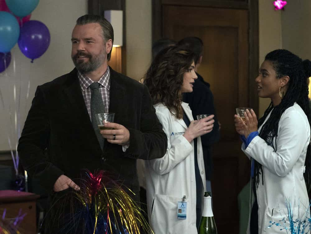 """NEW AMSTERDAM Season 3 Episode 7 -- """"The Legend of Howie Cournemeyer"""" Episode 307 -- Pictured: (l-r) Tyler Labine as Dr. Iggy Frome, Janet Montgomery as Dr. Lauren Bloom, Freema Agyeman as Dr. Helen Sharpe -- (Photo by: Virginia Sherwood/NBC)"""