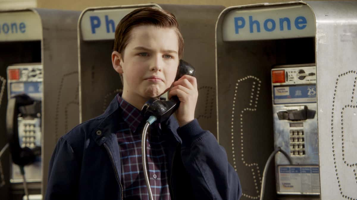 """Young Sheldon Season 4 Episode 14 """"Mitch's Son and the Unconditional Approval of a Government Agency"""" - Pictured: Sheldon (Iain Armitage). When the IRS accuses Sheldon of making a mistake, he'll stop at nothing to prove them wrong. Also, Dale is forced to get a colonoscopy and tries to convince Meemaw to join him, on Thursday, April 15 (8:00-8:31 PM, ET/PT) on the CBS Television Network. Photo: Screen Grab/©2021 Warner Bros. Entertainment Inc.  All Rights Reserved."""