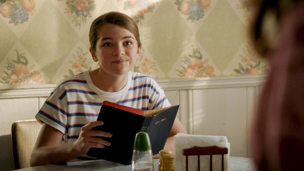 """Young Sheldon Season 4 Episode 14 """"Mitch's Son and the Unconditional Approval of a Government Agency"""" - Pictured: Missy (Raegan Revord). Sheldon (Iain Armitage). When the IRS accuses Sheldon of making a mistake, he'll stop at nothing to prove them wrong. Also, Dale is forced to get a colonoscopy and tries to convince Meemaw to join him, on Thursday, April 15 (8:00-8:31 PM, ET/PT) on the CBS Television Network. Photo: Screen Grab/©2021 Warner Bros. Entertainment Inc.  All Rights Reserved."""