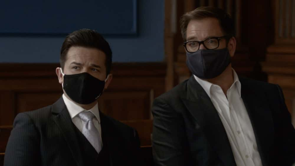 """Bull Season 5 Episode 12 """"Evidence to the Contrary"""" – Bull and the TAC team worry about jury bias when Bull mounts a murder trial defense for a Black Lives Matter activist who is also the son of the wrongly convicted man who inspired Bull to start his trial science company, on BULL, Monday, April 19 (10:00-11:00 PM, ET/PT) on the CBS Television Network.  Pictured L-R: Freddy Rodriguez as Benny Colón and Michael Weatherly as Dr. Jason Bull Photo: Screen Grab/CBS ©2021 CBS Broadcasting, Inc. All Rights Reserved."""