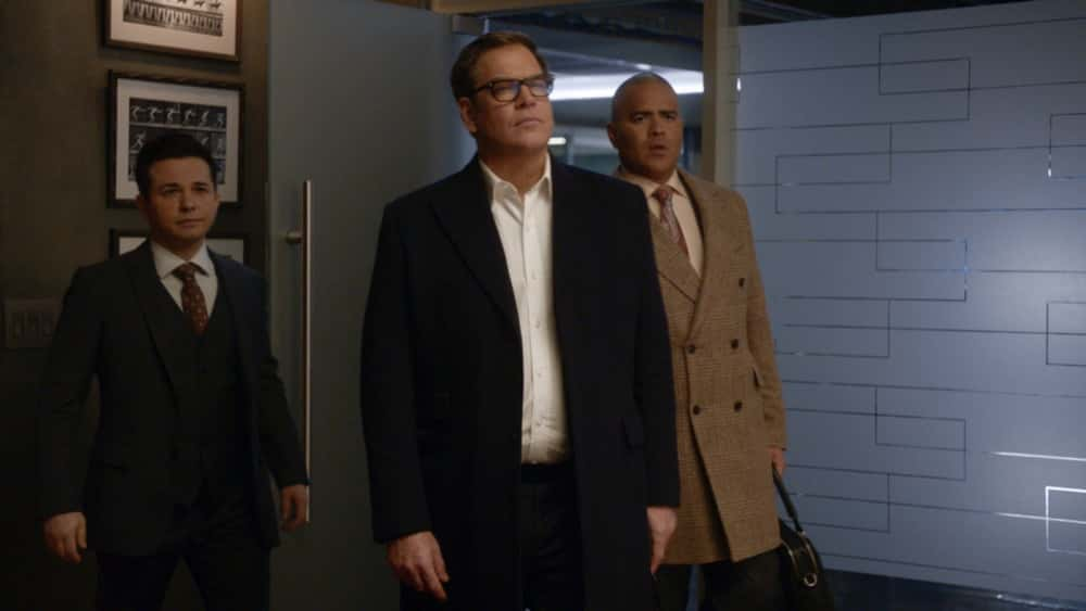 """Bull Season 5 Episode 12 """"Evidence to the Contrary"""" – Bull and the TAC team worry about jury bias when Bull mounts a murder trial defense for a Black Lives Matter activist who is also the son of the wrongly convicted man who inspired Bull to start his trial science company, on BULL, Monday, April 19 (10:00-11:00 PM, ET/PT) on the CBS Television Network. Pictured L-R: Freddy Rodriguez as Benny Colón, Michael Weatherly as Dr. Jason Bull, and Christopher Jackson as Chunk Palmer  Photo: Screen Grab/CBS ©2021 CBS Broadcasting, Inc. All Rights Reserved."""