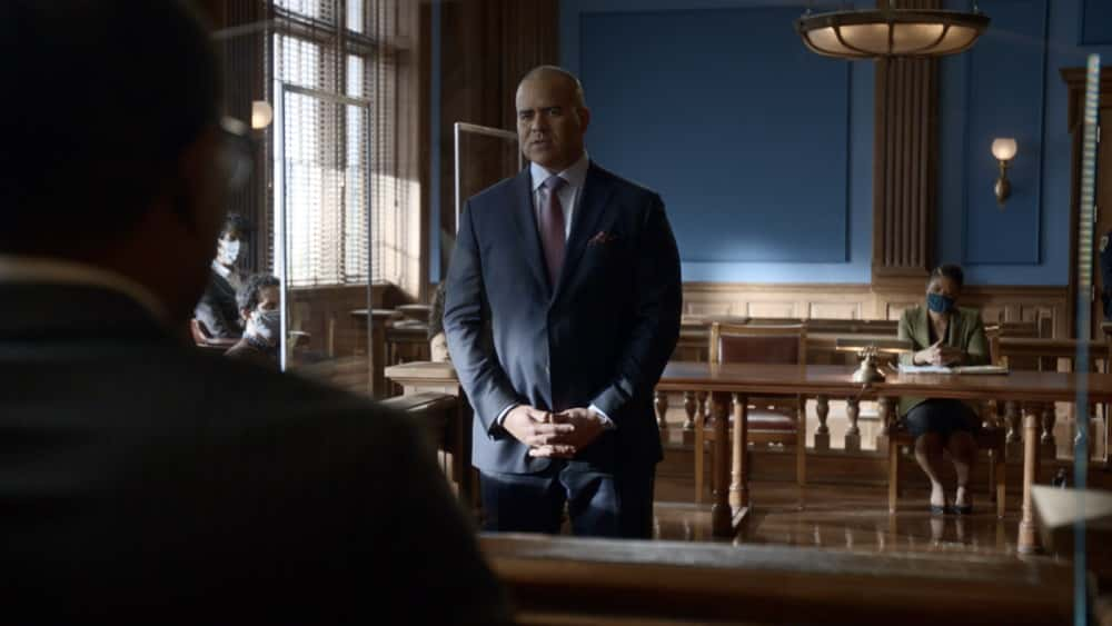 """Bull Season 5 Episode 12 """"Evidence to the Contrary"""" – Bull and the TAC team worry about jury bias when Bull mounts a murder trial defense for a Black Lives Matter activist who is also the son of the wrongly convicted man who inspired Bull to start his trial science company, on BULL, Monday, April 19 (10:00-11:00 PM, ET/PT) on the CBS Television Network.  Pictured L-R: Christopher Jackson as Chunk Palmer and Adrianna Mitchell as ADA Olson Photo: Screen Grab/CBS ©2021 CBS Broadcasting, Inc. All Rights Reserved."""