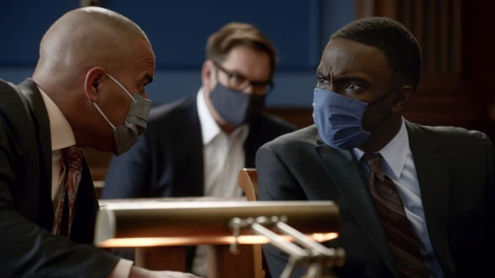 """Bull Season 5 Episode 12 """"Evidence to the Contrary"""" – Bull and the TAC team worry about jury bias when Bull mounts a murder trial defense for a Black Lives Matter activist who is also the son of the wrongly convicted man who inspired Bull to start his trial science company, on BULL, Monday, April 19 (10:00-11:00 PM, ET/PT) on the CBS Television Network.  Pictured L-R: Christopher Jackson as Chunk Palmer, Michael Weatherly as Dr. Jason Bull, and Adams Desir as Leo Craddick Photo: Screen Grab/CBS ©2021 CBS Broadcasting, Inc. All Rights Reserved."""