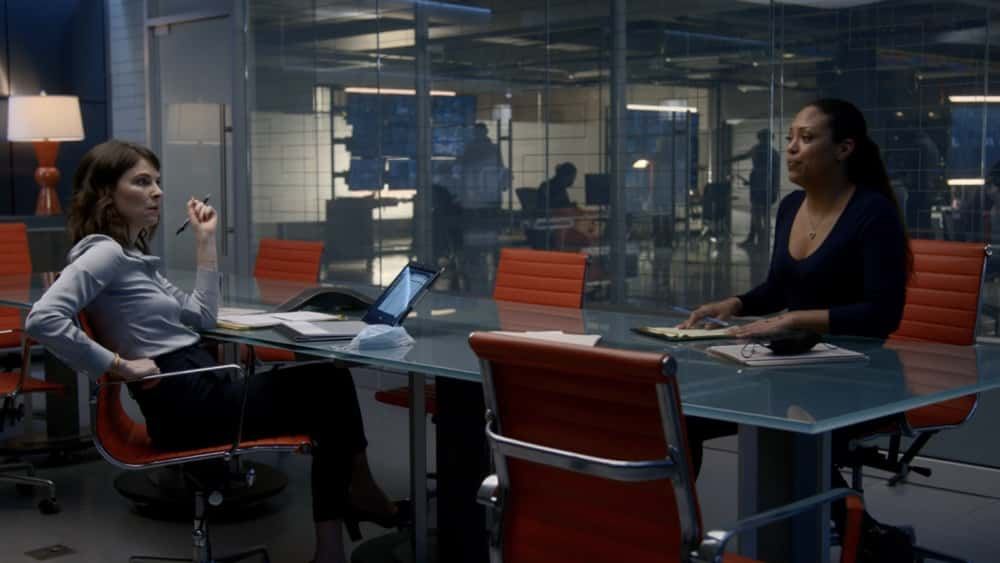 """Bull Season 5 Episode 12 """"Evidence to the Contrary"""" – Bull and the TAC team worry about jury bias when Bull mounts a murder trial defense for a Black Lives Matter activist who is also the son of the wrongly convicted man who inspired Bull to start his trial science company, on BULL, Monday, April 19 (10:00-11:00 PM, ET/PT) on the CBS Television Network.  Pictured L-R: MacKenzie Meehan as Taylor Rentzel and Jaime Lee Kirchner as Danny James  Photo: Screen Grab/CBS ©2021 CBS Broadcasting, Inc. All Rights Reserved."""
