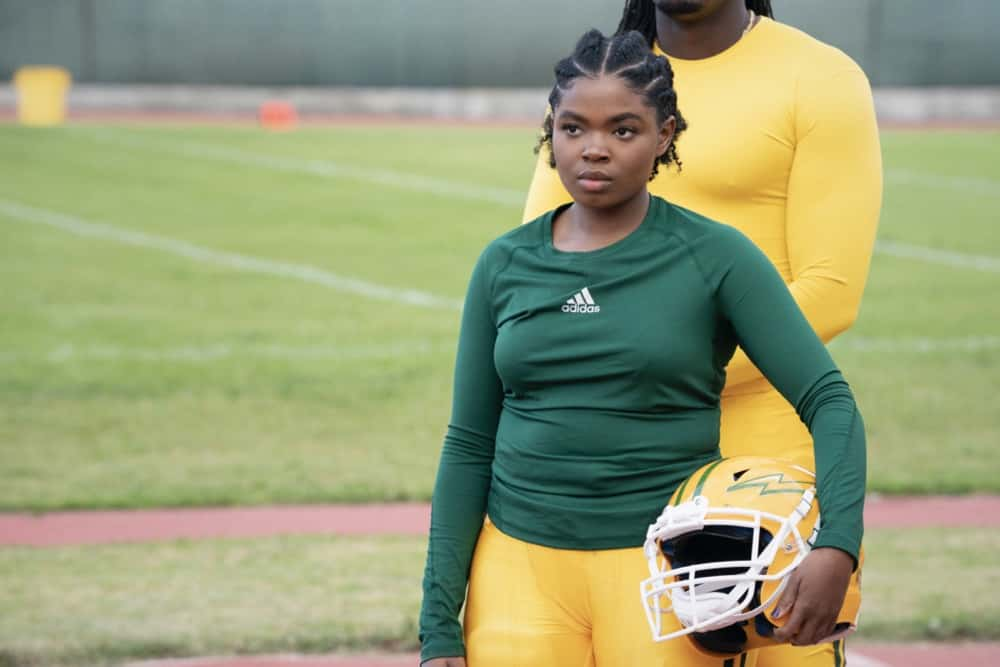 "All American Season 3 Episode 10 -- ""Put Up or Shut Up"" -- Image Number: ALA310b_0015r.jpg -- Pictured: Kyanna Simone as Nhani  -- Photo: Erik Voake/The CW -- © 2021 The CW Network, LLC. All Rights Reserved"