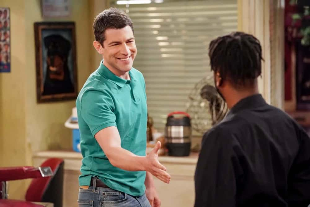 """The Neighborhood Season 3 Episode 14 """"Welcome to the Hero"""" – Pictured: Max Greenfield (Dave Johnson). Dave earns Calvin's respect when he thwarts a robbery at the barbershop, until the recognition goes to his head and he starts exaggerating the truth. Also, Marty invites an anxious Gemma to give his new stress-busting hobby a try, on THE NEIGHBORHOOD, Monday, April 19 (8:00-8:30 PM, ET/PT) on the CBS Television Network. Photo: Monty Brinton/CBS ©2021 CBS Broadcasting, Inc. All Rights Reserved."""